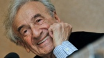 In this Dec. 10, 2009 file photo, Elie Wiesel smiles during a news conference in Budapest, Hungary. (Bela Szandelszky/AP)