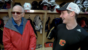83-year-old former sportswriter Don Winsor and his grandson Matthew Phillips, who's trying out for the Flames.