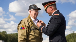 World War II veteran Clarence Smoyer, 96, receives the Bronze Star from U.S. Army Maj. Peter Semanoff at the World War II Memorial, Wednesday, Sept. 18, 2019, in Washington. Smoyer fought with the U.S. Army's 3rd Armored Division, nicknamed the Spearhead Division. In 1945, he defeated a German Panther tank near the cathedral in Cologne, Germany — a dramatic duel filmed by an Army cameraman that was seen all over the world. (AP Photo/Alex Brandon)