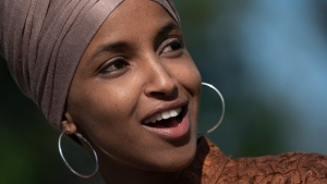 In this July 25, 2019, file photo, Rep. Ilhan Omar, D-Minn., speaks as she introduces the Zero Waste Act at the Capitol in Washington. U.S. President Donald Trump shared a false video on Twitter made by a conservative comedian that accused Omar of dancing on the anniversary of the 9/11 terrorist attacks. (AP Photo/J. Scott Applewhite, File)