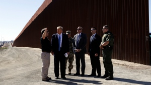 U.S. President Donald Trump tours a section of the southern border wall, Wednesday, Sept. 18, 2019, in Otay Mesa, Calif. (AP Photo/Evan Vucci)