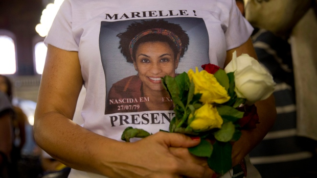 In this March 14, 2019 file photo, a woman wears a T-shirt designed with an image of slain councilwoman Marielle Franco during a memorial Mass to mark the one-year anniversary of her death, at the Candelaria Catholic Church in Rio de Janeiro, Brazil. Outgoing Brazilian Attorney General Raquel Dodge requested on Tuesday, Sept. 17, that five people be charged with obstructing justice in the case of councilwoman Franco. (AP Photo/Silvia Izquierdo, File)