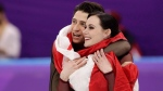 """Tessa Virtue and Scott Moir of Canada celebrate during the venue ceremony after winning the gold medal in the ice dance, free dance figure skating final in the Gangneung Ice Arena at the 2018 Winter Olympics in Gangneung, South Korea, Tuesday, Feb. 20, 2018. Canadian ice dancing stars Tessa Virtue and Scott Moir say they are """"stepping away"""" from the sport. THE CANADIAN PRESS/AP-David J. Phillip"""