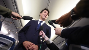 "Liberal Leader Justin Trudeau responds to a question after making a statement in regards to photo coming to light of himself from 2001 wearing ""brownface"" during a scrum on his campaign plane in Halifax, N.S., on Wednesday, September 18, 2019. THE CANADIAN PRESS/Sean Kilpatrick"