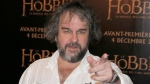 "In this Dec. 4, 2014, file photo, director Peter Jackson poses for photos at the screening of his film The Hobbit. Amazon announced Wednesday, Sept. 18, 2019, it will film its upcoming television series ""The Lord of the Rings"" in New Zealand, marking a return of the orcs, elves and hobbits to the country they became synonymous with over the course of six movies directed by Peter Jackson. (AP Photo/Francois Mori, File)"