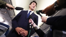 Liberal Leader Justin Trudeau responds to a question after making a statement in regards to photo coming to light of himself from 2001 wearing 'brownface' during a scrum on his campaign plane in Halifax, N.S., on Wednesday, September 18, 2019. THE CANADIAN PRESS/Sean Kilpatrick