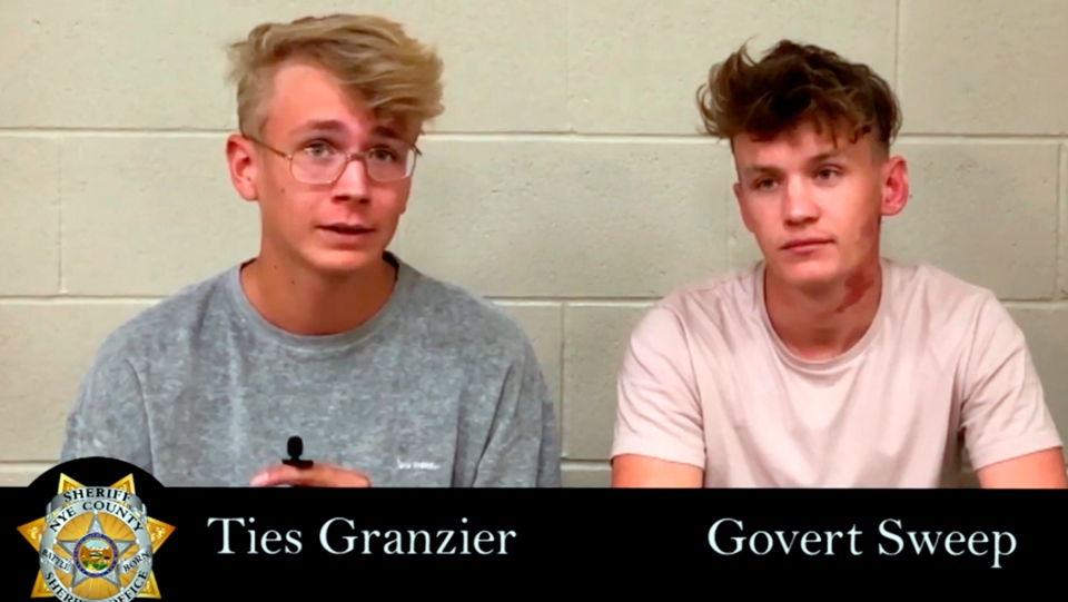 This image taken from video posted by the Nye County Sheriff's Office on Tuesday, Sept. 17, 2019, shows a recorded police interview with Dutch tourists Ties Granzier, left, and Govert Sweep, in the Nye County Jail in Pahrump, Nev. The pair, who wanted to take video of Area 51, have pleaded guilty to misdemeanor trespass and illegal parking following their arrests at the secure U.S. government site in Nevada. A judge on Monday, Sept. 16, 2019 sentenced both to three days in jail and fined them $2,280 apiece.(Nye County Sheriff's Office via AP)