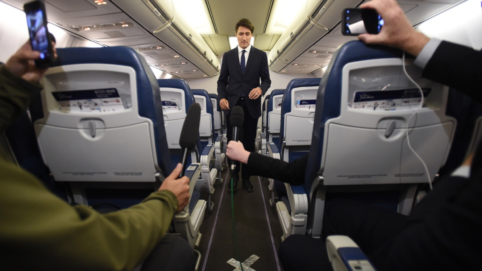 Trudeau before a scrum on his campaign plane