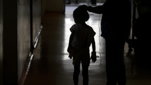 A young patient walks inside the San Lazaro government hospital in Manila, Philippines on Aug. 7, 2019. (Aaron Favila / AP)