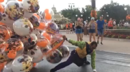 Disney World balloon guy faces down stiff breeze