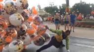 Disney World balloon guy faces down stiff breeze