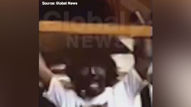 This image, taken from a video shot in the early 1990s and obtained by Global News, shows Liberal Leader Justin Trudeau in blackface. (Source: Global News).