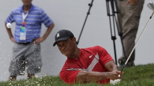 Tiger Woods hits from a bunker