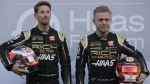 Drivers Kevin Magnussen, right, and Romain Grosjean, left, pose for photographers at the Barcelona Catalunya racetrack in Montmelo, Spain, on Feb.18, 2019. (Manu Fernandez / AP)