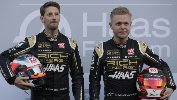 Kevin Magnussen, right, and Romain Grosjean