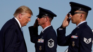 U.S. President Donald Trump boards Air Force One at Marine Corps Air Station Miramar, Wednesday, Sept. 18, 2019, in San Diego, Calif. (AP Photo/Evan Vucci)