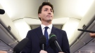 Liberal Leader Justin Trudeau makes a statement in regards to photo coming to light of himself from 2001 wearing 'brownface' during a scrum on his campaign plane in Halifax, N.S., on Wednesday, September 18, 2019. THE CANADIAN PRESS/Sean Kilpatrick