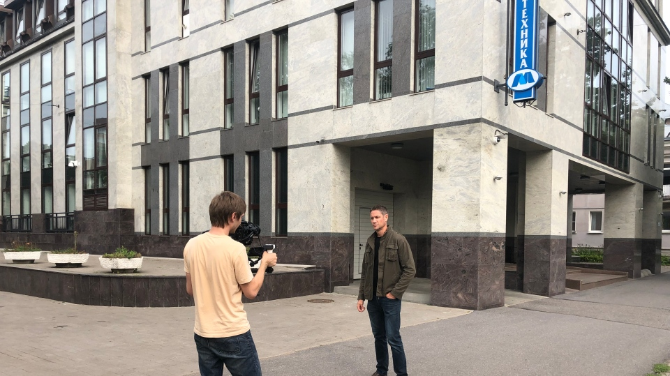 W5's Peter Akman, right, filming outside of the offices of the Internet Research Agency in St. Petersburg, Russia.