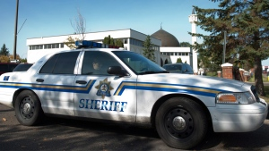 A sheriff's car sits outside the funeral for a two-year-old girl at the Al Rashid mosque in Edmonton on Saturday, September 22, 2012. THE CANADIAN PRESS/Ian Jackson