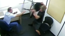 Curtis Sagmoen, right, is seen picking up a chair during his interrogation in September 2017.
