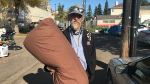 "George Bain was one of many moving Thursday in search of new shelter after a ""tent city"" was started near the Bissell Centre last week."