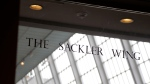 In this Jan. 17, 2019, file photo, a sign with the Sackler name is displayed at the Metropolitan Museum of Art in New York. Their name used to be on a wing at the Louvre. But now the Sackler family wealth has become linked to sales of OxyContin, and their company, drug maker Purdue Pharma, is attempting to settle lawsuits over the opioid crisis. (AP Photo/Seth Wenig, File)