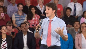 Justin Trudeau speaks at a town hall in Saskatoon.