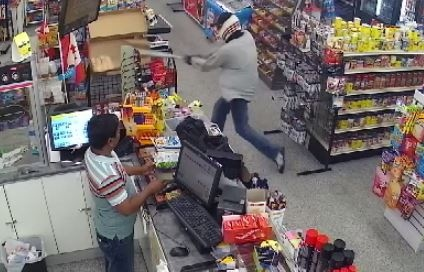 Security video shows suspect swinging baseball bat in Saskatoon convenience store robbery