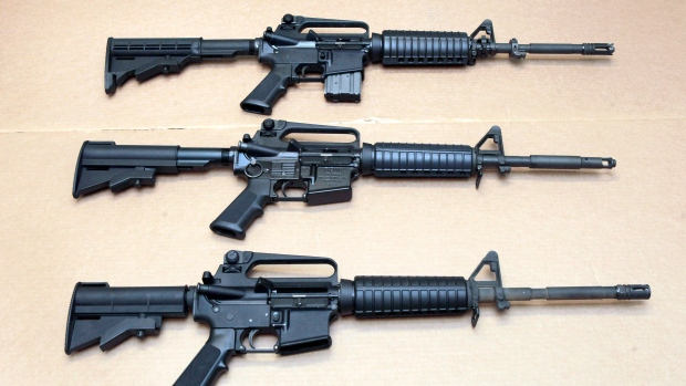 In this Aug. 15, 2012 file photo, three variations of the AR-15 rifle are displayed at the California Department of Justice in Sacramento, Calif. On Sept. 19, 2019, Connecticut-based Colt Firearms said it was suspending production of its version of the AR-15 for the civilian market. (AP Photo/Rich Pedroncelli, File)
