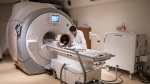 A member of a medical team prepares a MRI machine before a procedure at Toronto's Sunnybrook Hospital on Tuesday May 1, 2018. (THE CANADIAN PRESS/Chris Young)