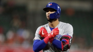 Toronto Blue Jays' Lourdes Gurriel Jr. reacts after hitting an RBI single off Baltimore Orioles relief pitcher Dillon Tate during the seventh inning of a baseball game Thursday, Sept. 19, 2019, in Baltimore. The Blue Jays won 8-4. (AP Photo/Julio Cortez)