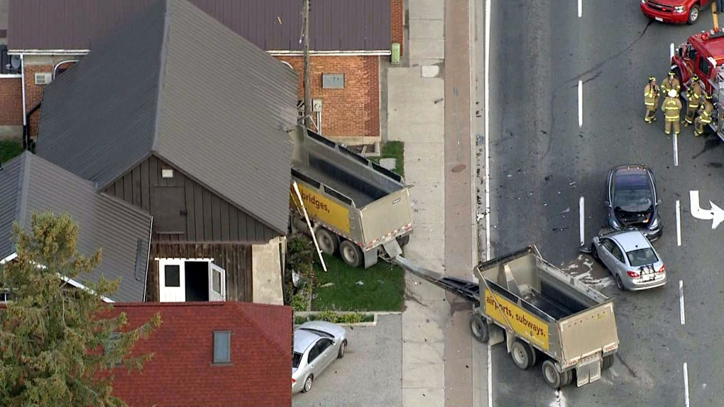 Dump truck crashes into cars and building in Caledon