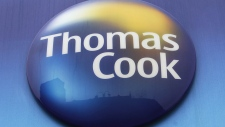 A sign of Thomas Cook travel agent is seen at a branch in London, on Nov. 22, 2011. (Sang Tan / AP)