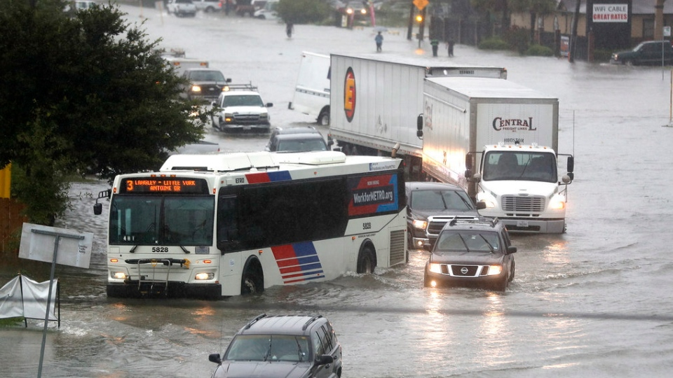 Cars and trucks try to navigate the floodwaters at the intersection of I-59 North and Little York Road as rain poured from the remnants of Imelda, Thursday, Sept. 19, 2019, in Houston. (Karen Warren/Houston Chronicle)