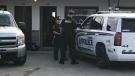 Police investigate a reported assault at the Casa Blanca Motel in London, Ont. on Friday, Sept. 20, 2019.