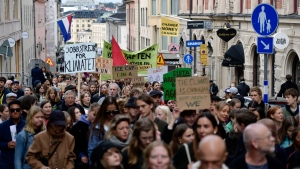 Climate protesters demonstrate in central Stockholm, Sweden, Friday, Sept. 20, 2019. (Stina Stjernkvist/TT via AP)