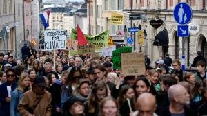Climate protesters demonstrate in central Stockholm, Sweden, Friday, Sept. 20, 2019. (Stina Stjernkvist/TT via AP)