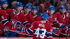 Montreal Canadiens' Jordan Weal is congratulated by teammates after scoring past Florida Panthers goaltender Sam Montembeault during a shoot out in pre-season NHL hockey action in Montreal on Thursday, September 19, 2019. THE CANADIAN PRESS/Paul Chiasson
