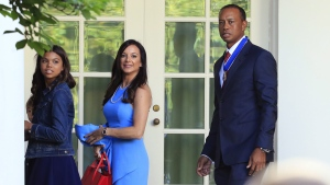 Tiger Woods, right with his daughter Sam Alexis Woods, left, and his girlfriend Erica Herman, centre, at the White House on May 6, 2019. (Manuel Balce Ceneta / AP)