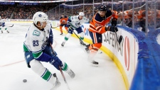 Vancouver Canucks' Jay Beagle (83) and Edmonton Oilers' Matt Benning (83) battle for the puck during first period NHL preseason action in Edmonton, Alta., on Thursday September 19, 2019. THE CANADIAN PRESS/Jason Franson