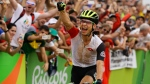 In this Saturday, Aug. 20, 2016 file photo, Nino Schurter of Switzerland celebrates after finishing first in the men's cross-country cycling mountain bike race at the 2016 Summer Olympics in Rio de Janeiro, Brazil. Olympic cycling champion Nino Schurter faces being reprimanded by the Swiss Army after posting a photo on social media showing his bare behind outside the White House. (AP Photo/Victor R. Caivano, File)