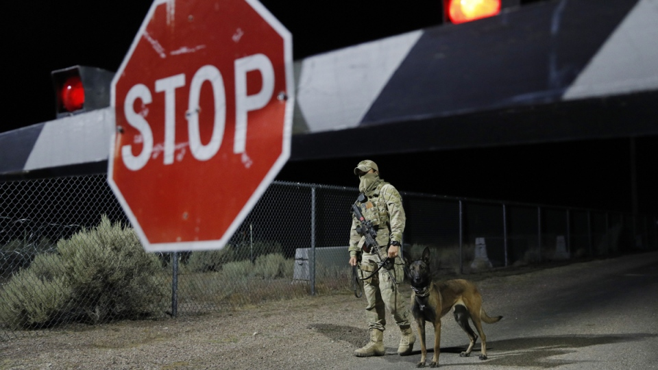 A security guard stands at an entrance to the Nevada Test and Training Range near Area 51, on Sept. 20, 2019. (John Locher / AP)