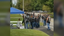 A little Indiana girl running a lemonade stand got quite the surprise from a large group of bikers who stopped by for a drink of the 'best lemonade in the state!' (Phil Shrock)