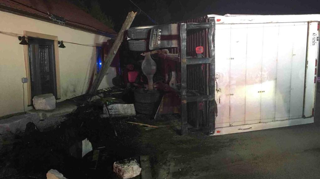 Bradford couple startled awake as truck slams into house porch