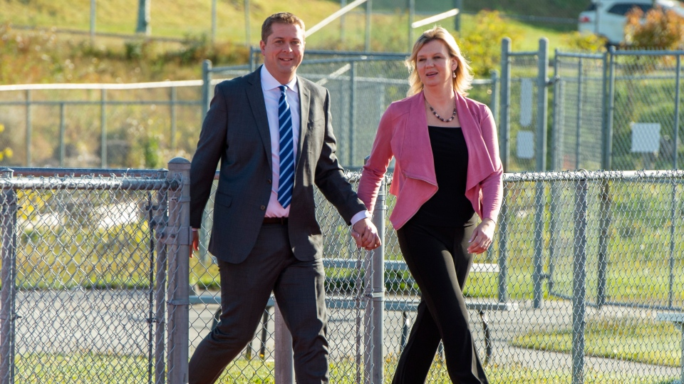 Federal Conservative leader Andrew Scheer and his wife Jill arrive to make a campaign announcement in Saint John, N.B. on Friday September 20, 2019. (THE CANADIAN PRESS/Frank Gunn)