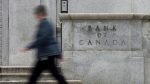 A woman walks past the Bank of Canada Wednesday September 6, 2017 in Ottawa. (THE CANADIAN PRESS/Adrian Wyld)