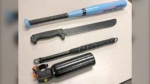 A machete, baseball bat, baton and bear spray were seized by police near the Lethbridge Supervised Consumption Site. (Lethbridge police)