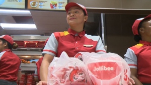 Employees at the grand opening of Calgary's first Jollibee on September 20, 2019
