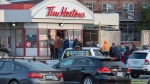 Customers line up at a Tim Hortons on Sunday, Sept. 8, 2019. The City of Fredericton will spend $40,000 to direct motorists around a busy Tim Hortons, in the latest move by a Canadian municipality to curb traffic headaches and other concerns caused by restaurant drive-thrus. (THE CANADIAN PRESS/Andrew Vaughan)