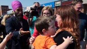 NDP Leader Jagmeet Singh speaks with a woman who stopped to listen to him speak at a campaign stop in Essex, Ont., Friday, Sept. 20, 2019. THE CANADIAN PRESS/Adrian Wyld